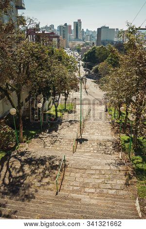 Bento Goncalves, Brazil - July 11, 2019. Staircase In A Garden Full Of Trees And Vegetation In The C