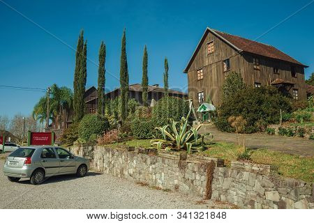 Bento Goncalves, Brazil - July 11, 2019. Charming Wooden Rural House In A Garden With Trees And Park