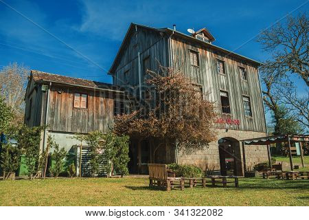 Bento Goncalves, Brazil - July 11, 2019. Charming Old Rural House Made Of Wood And Stone From The Re
