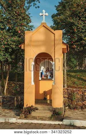 Bento Goncalves, Brazil - July 13, 2019. Catholic Shrine With Statuettes Of Saints In Naive Style Ma