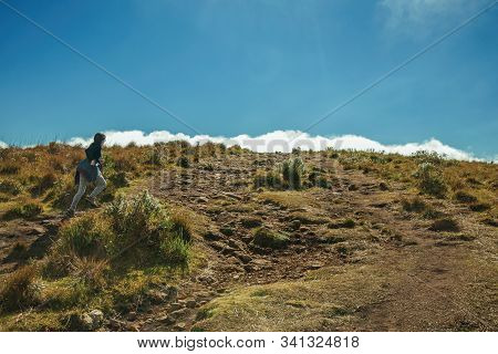 Cambara Do Sul - Brazil, July 18, 2019. Girl On Rocky Trail Running Up To The Top Of Fortaleza Canyo