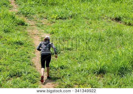 Trail Runner. Sporty Woman Runner Running Trail Through The Road Up To Mountain. People Strong Worko