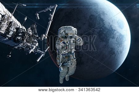 Astronaut, Iss In Orbit Of The Moon. Solar System. Science Fiction. Elements Of This Image Furnished