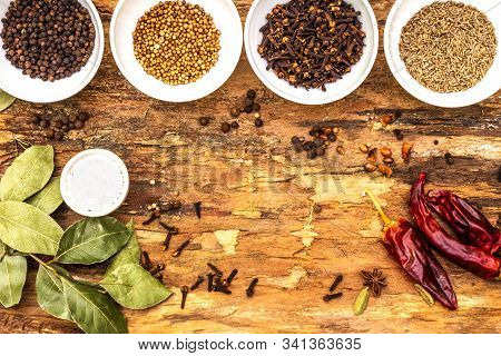 Set Of Different Spices And Herbs - Black Pepper, Allspice, Cumin, Hot Pepper, Bay Leaf, Coriander,