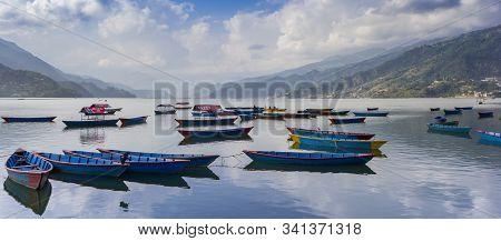 Pokhara, Nepal - November 11, 2019: Panorama Of Wooden Row Boats On Lake Phewa In Pokhara, Nepal