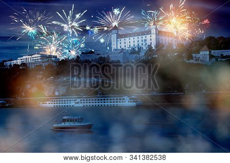 Celebrate Abstract Holidays In Bratislava, Slovakia, Europe. Christmas Or New Year Fireworks At Nigh