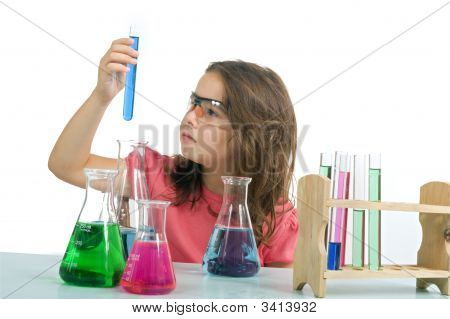 young girl examining a test tube in a science class poster