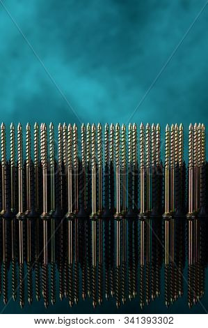 Screws And Dowels On Glass On Turquoise Background. Symbol Of Team Work, Invincibility And Power Of