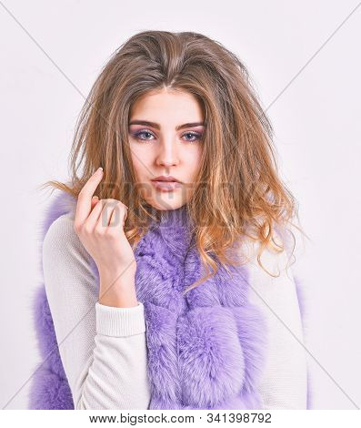 Girl Fur Coat Posing With Hairstyle On White Background. Hair Care Concept. Prevent Winter Hair Dama
