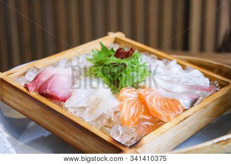 Japanese Cuisine Sashimi Salmon And Raw Fish Sashimi Salad On Ice Served On Wooden Tray In The Japan