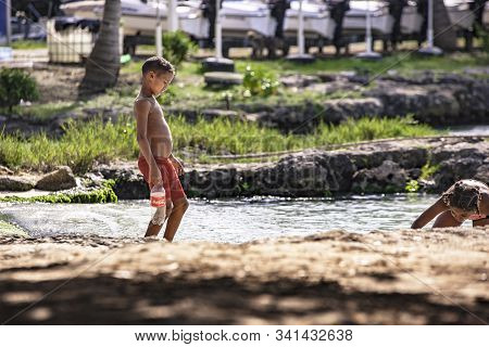 Poor Dominican Children Play In Bayahibe 4
