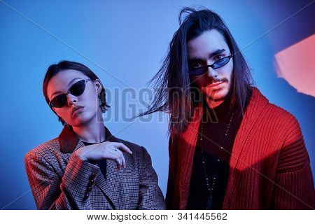Trendy People In Fashionable Clothing Are Posing For Photographer At Photo Studio.