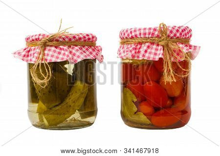 Canned Vegetables. Red Tomatoes And Green Cucumbers In Brine In The Bank
