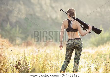 Back View Sexy Military Fashion Girl With Rifle With An Optical Sight. Female Chase Sport Hunter In