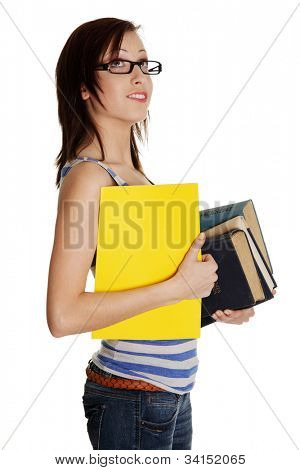 Woman holding books and folder. She wears black glasses. Isolated on the white background.