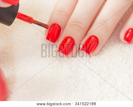 Manicure - Beautiful Manicured Womans Nails With Red Nail Polish On Soft White Towel.