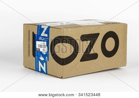 St. Petersburg, Russia - December 25, 2019: Cardboard Box From Kraft Paper, Retailer Parcel Of Ozon