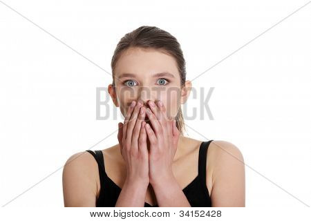 Young woman covering the mouth. She shows emotions. Isolated on the white background.