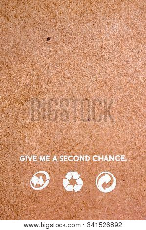 Reuse Background. Words On Craft Paper. Recycle Icons On Brown Paper. Give Me A Second Chance. World