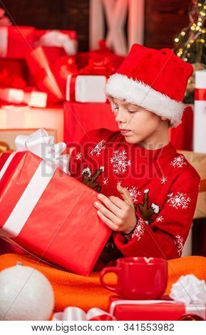 Kid Santa Hat Christmas Gift Boxes. Merry Christmas. Beauty Of Winter. Leisure And Activity. Boxing