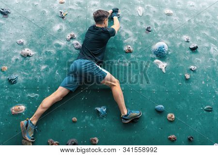 Young Man On Wall. Rock-climbing. Climbing Icon