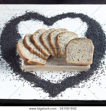Black Sesame Sourdough Bread Slices Placed In A Heart Shaped Black Sesame Seeds