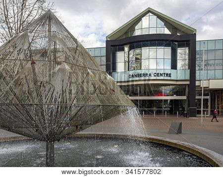 Canberra, Australia - Sep 3, 2018: View Of The Canberra Times Fountain In The Foreground. Entrance T