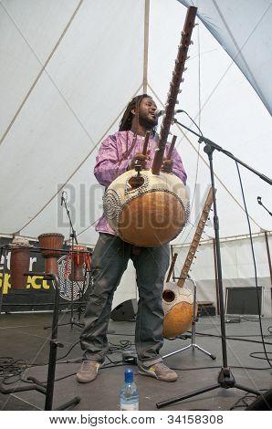 Modou N'Diaye plays the Kora live on the Global Community Stage