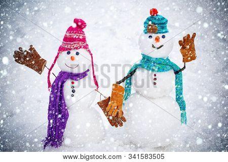 A Loving Couple Of Snowmen. Christmas Background With Couple Of Snowman. Snowman Couple Outdoor. Cut