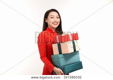 Asian Woman With Ao Dai And Hold Big Gift Boxes