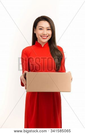 Pretty Asian Woman In Traditional Dress Holding Present For Tet Celebration