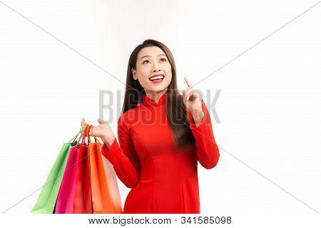 Beauty Women Wear Ao Dai And Take Shopping Bag In Lunar New Year
