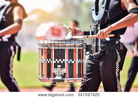 Close Up Of Marching Band Drummers Marching