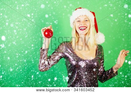 Beauty Model Girl In Santa Hat On Green Background Isolated. Fashion Portrait Of Girl. Sensual Girl
