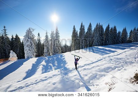 Happy Woman With Skis In Center Of Amazing Panoramic View Of Sky And Forest. Snow-covered Mountain H