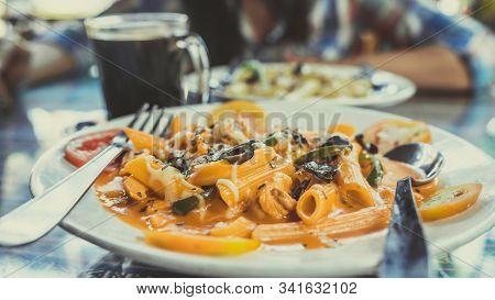 Delicious Pasta With Tomato Sauce. Silverware Placed On Plate Of Palatable Pasta With Tomato Sauce A