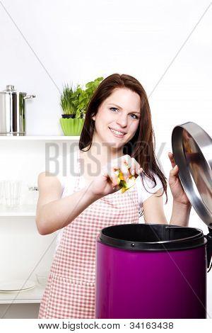 throwing away some organic waste