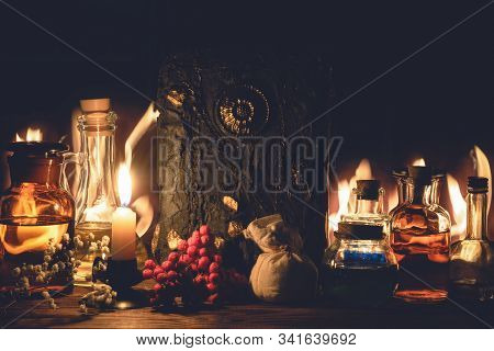 Magic Book And Potions On The Wizard Table Background. Alchemist Art.