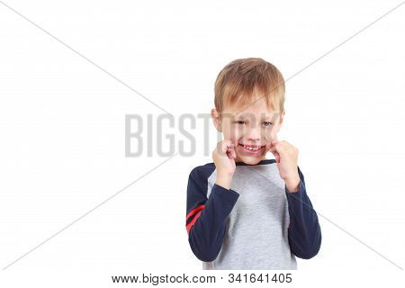 A Six-year-old Boy Does Articulation Exercises For The Development Of Speech On White Background. Sp