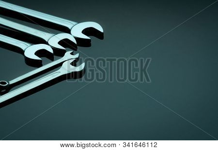 Set Of Chrome Wrenches Or Spanners Isolated On Glass Table In Workshop. Chrome Vanadium Spanner Wren