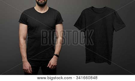 Cropped View Of Bearded Man Near Blank Basic Black T-shirt On Black Background