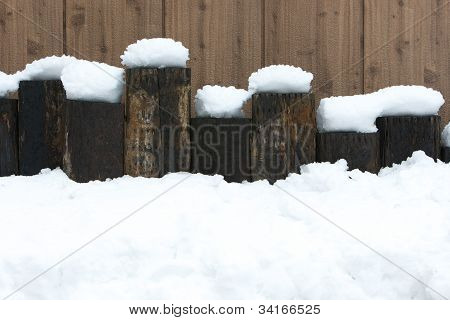 Lovely snow on wood