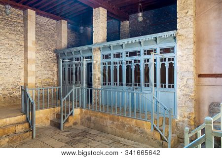 Changing rooms with blue wooden door shutters and wooden balustrades at abandoned historical traditional Turkish public bathhouse, Moez Street, Cairo, Egypt poster