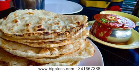 Delicious North Indian Cuisine Butter Chicken And Tandoori Roti