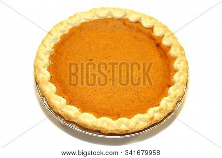 Pumpkin Pie. Fresh home made Pumpkin Pie. Isolated on white. Room for text. Thanksgiving and Holiday Treat. Clipping Path.