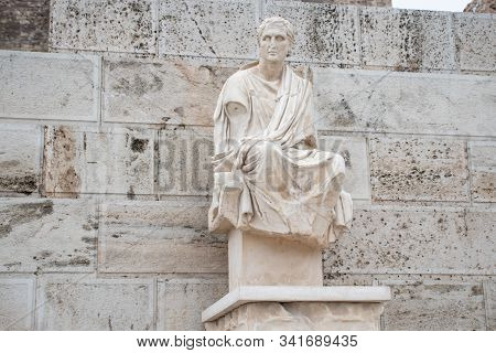 Ancient Greek Statue Close To The Theatre Of Dionysus At Acropoli Monument