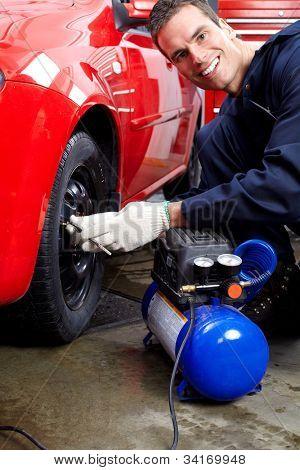 Professional mechanic working in auto repair service..