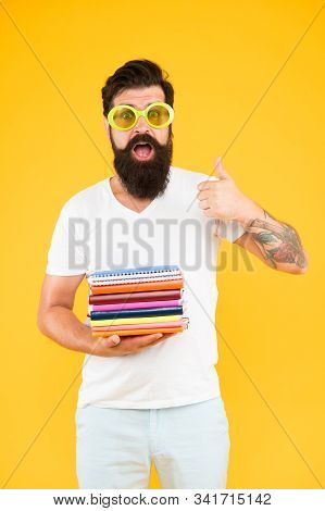 Stationery Admirer. Buy Sketchbooks. Hipster Eccentric Guy Hold Pile Notepads. Stationery Shop. Stud