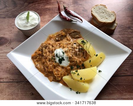 Hungarian Specialty Szegedin Or Szeged Goulash With Sour Cabbage And Boiled Potatoes. Meat In Which