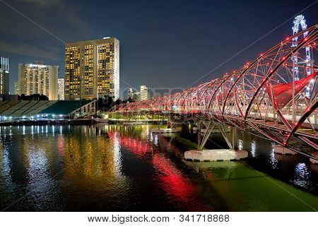 SINGAPORE - CIRCA APRIL, 2019: view of the Helix Bridge at the night. Helix Bridge is a pedestrian bridge linking Marina Centre with Marina South in the Marina Bay area in Singapore.